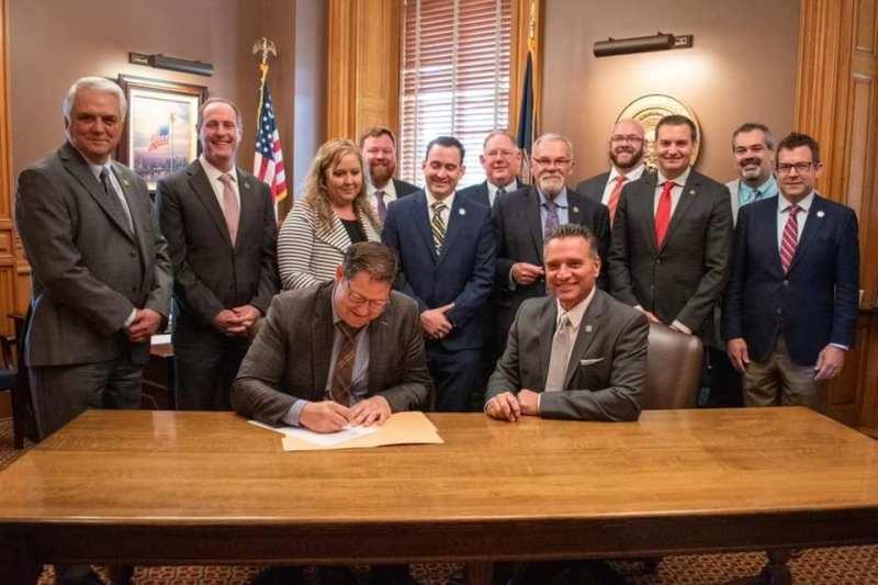 Kansas House Majority Whip Blake Carpetner holds a signing cerimony for HB2058