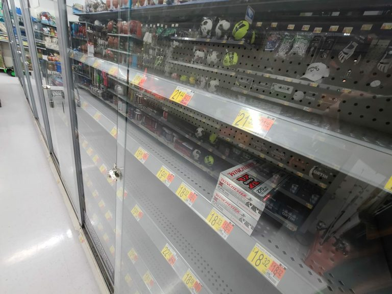 A nearly empty Walmart ammunition shelf from May 2021