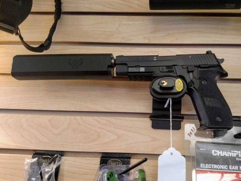 A Sig Sauer P226 equipped with a silencer