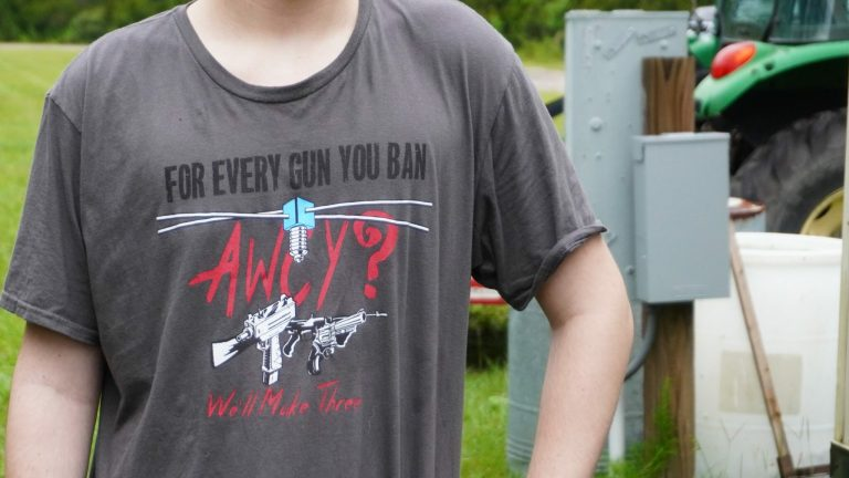 A member of AWCY? (Are We Cool Yet) wears the group's shirt at the Gun Makers Match