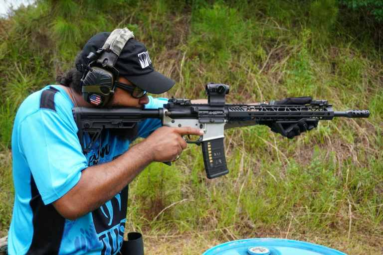 A competitor at the Gun Makers Match on June 19th, 2021 shoulders an AR-15
