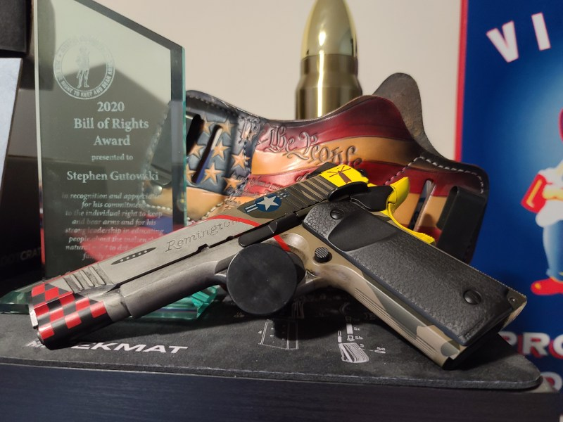 A 1911 pistol with a cerakoted paint job