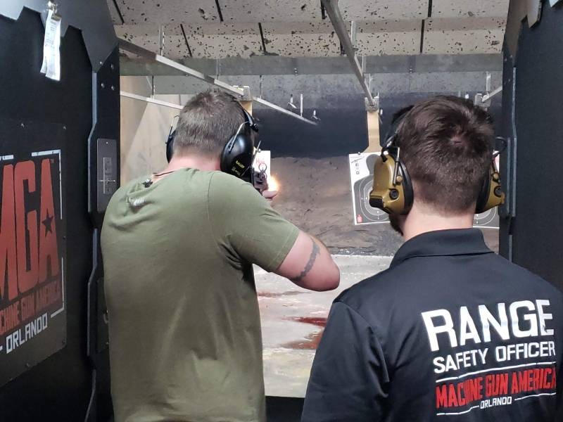 A customer shoots at a gun range