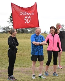 Celebrating his 50th parkrun in Stutterheim, from left, Caron Williams, runner Alan and his wife, Lesley Koopowitz