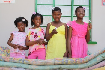 Komani girls, from left, Unoza Fanti, Sonke Maxim, Iviwe Mhambi and Matimu Mantshongo visited the Rep and collected mattresses donated to Phumelela Special Care Centre