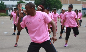 Trainer Brian Luthuli leads the group of aerobics fans at the Johnny's Gym marathon in aid of Cansa Picture: ABONGILE SOLUNDWANA
