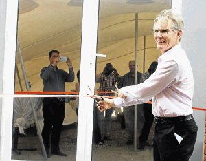 NEW BEGINNINGS: Cargo Carriers CEO Murray Bolton cuts the ribbon at the entrance of the new Ezethu Logistics satellite deport in Queendustria last weekPicture: BHONGO JACOB