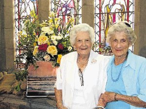 LOVE OF FLOWERS: Visitors from Cathcart who enjoyed the Friends of Madeira Garden Tour and St Michael's flower festival last weekend were, from left, Aileen Berrington and Berenice Waters Pictures: CHUX FOURIE