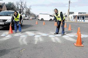 SLOWING MOTORISTS DOWN: Erecting the speed humps in Grey Street and Prince Alfred Street this week were Ivano Debruin, left, and Gregory Buys from Safety Xpress Stromberg Picture: BHONGO JACOB
