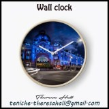 Wall clock showing the Flinders Street Station from Melbourne, Victoria in Australia. The building is lit with blue.