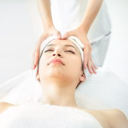 Leisure background, Beautiful girl is take a rest relaxing by handle soft massage on face. Caucasian is feeling good and sleep posture in luxury spa, Concept Health and Beauty Background.