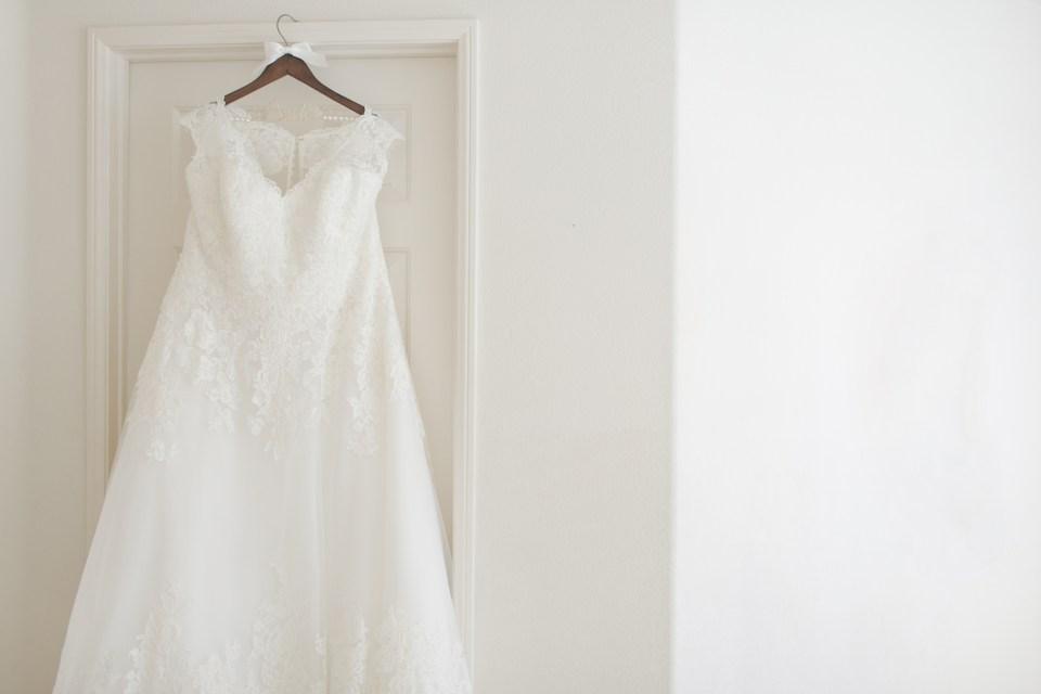 Wedding Dress on White Wall Photo