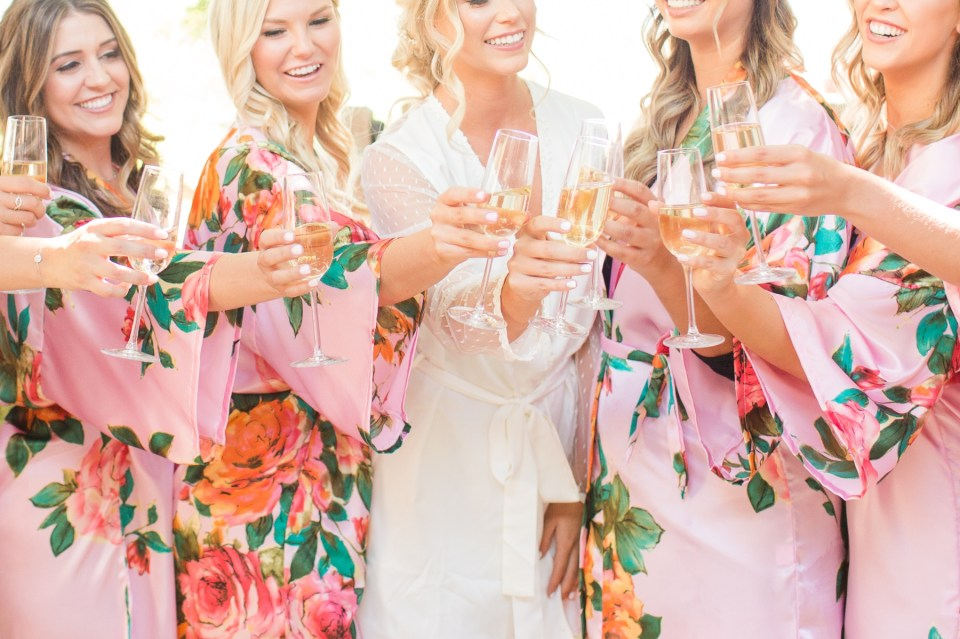 Bridesmaids toast on wedding day