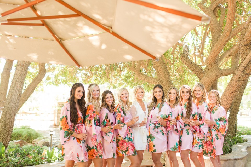 Bridesmaids in matching robes on wedding day