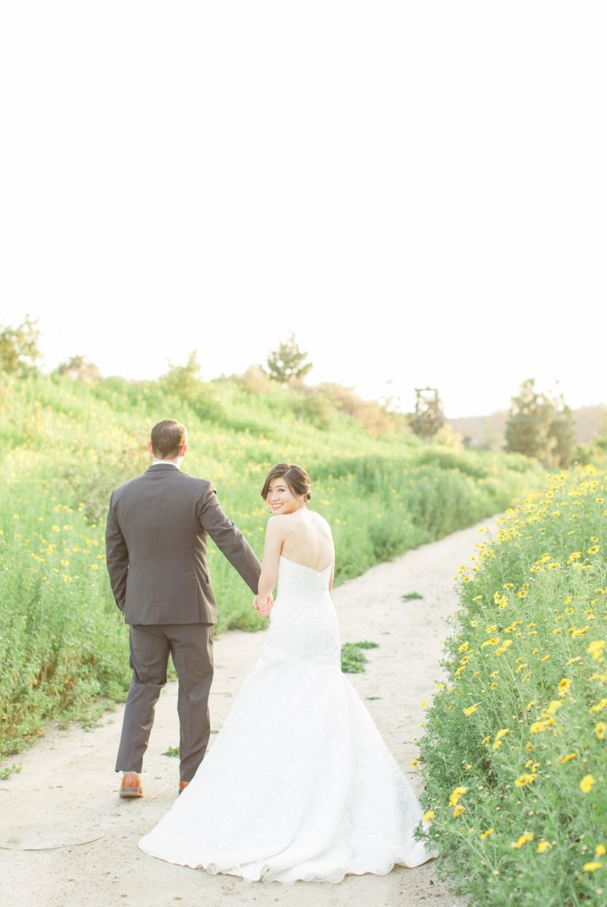 Bride and Groom in an open field Colorado Wedding Photographer Theresa Bridget Photography