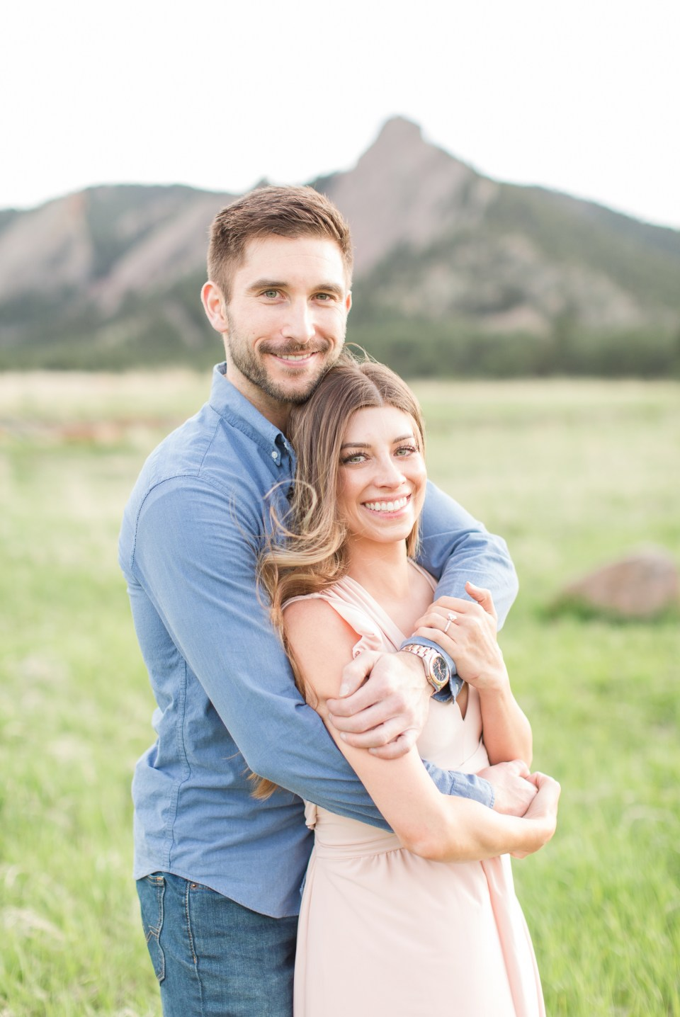 Couple looking at the camera smiling in Boulder Colorado.