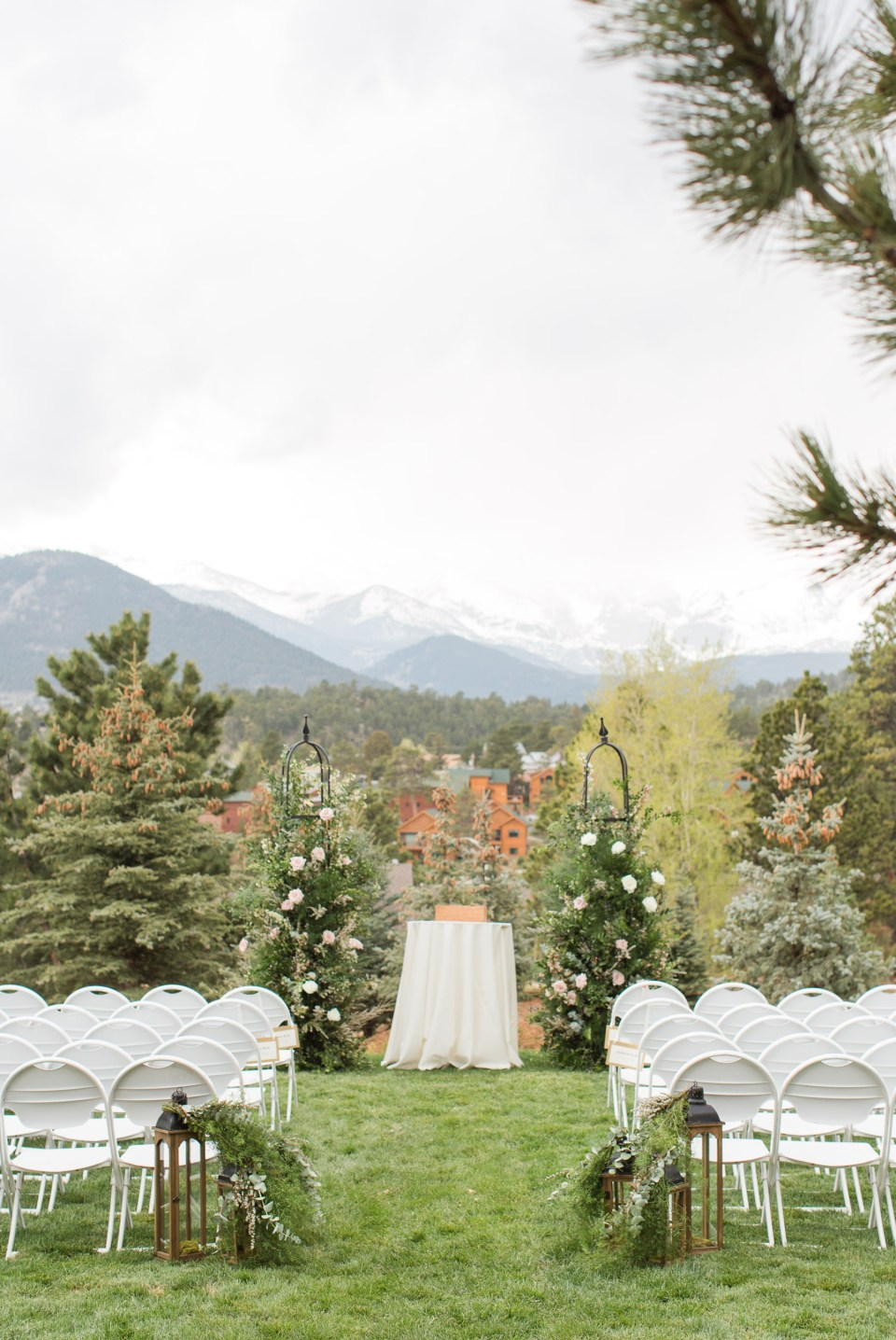 Wedding ceremony site at the Stanley Hotel with a view of Longs Peak in Estes Park Colorado. Colorado Wedding Photographer with mountain views.