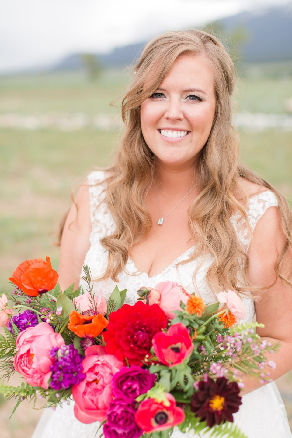 portrait of a bride at The Barn at Sunset ranch in Buena Vista Colorado. The barn at sunset ranch wedding venue with mountain views in Buena Vista Colorado.