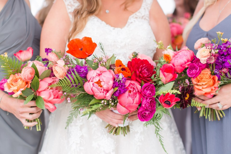 Bold wedding flowers in a whimsical bouquet by lace and lilies.