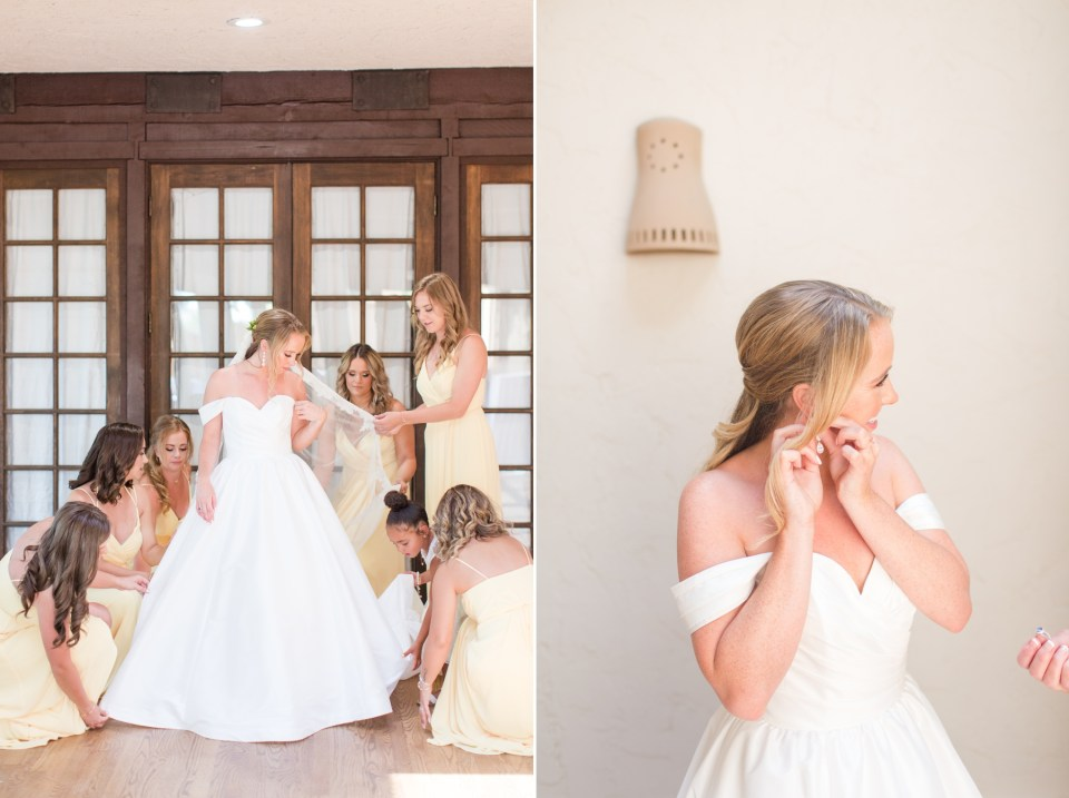 Bride getting ready with bridesmaids around her at villa parker in parker colorado.