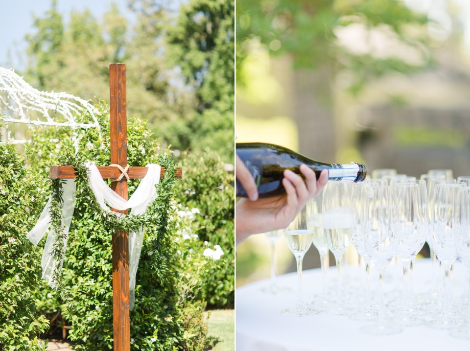 Waiter pouring a glass of champagne at an outdoor wedding.