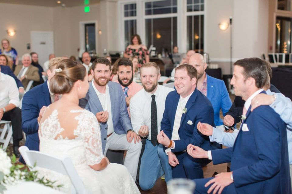 Frat brothers singing at a wedding