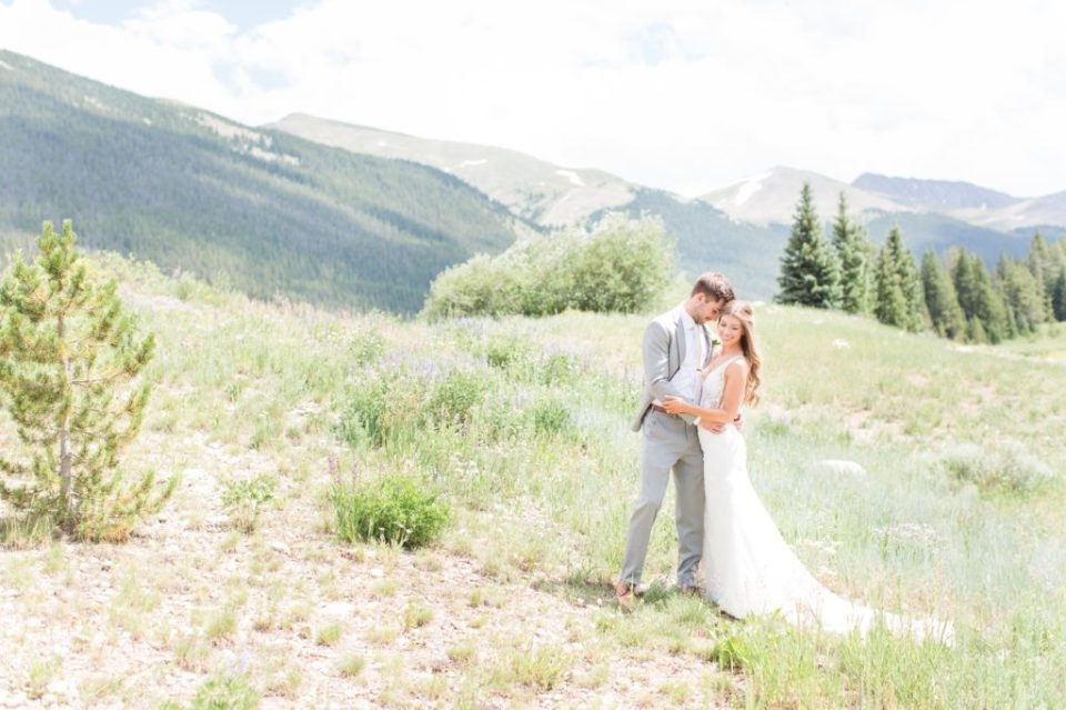 Bride and groom on-top of a mountain at Copper Mountain resort. Copper Mountain wedding resort.