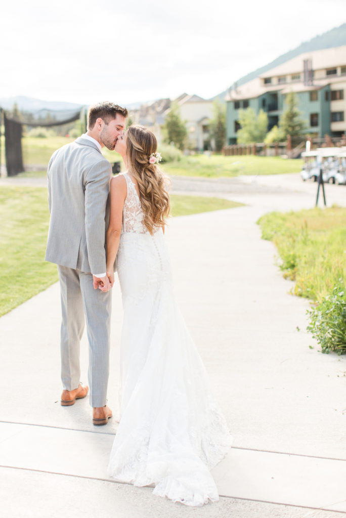 Bride and groom kiss after the wedding ceremony at Copper Mountain Station.