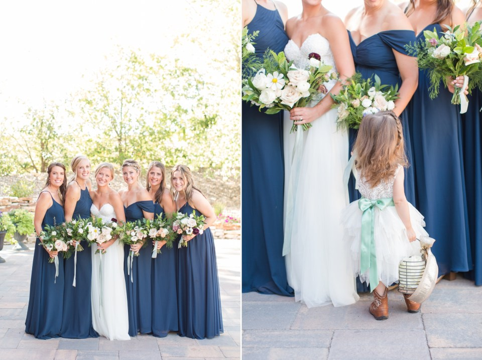 Navy bridesmaids dresses with wildflower wedding bouquets.