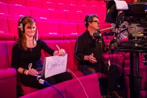 Holding up a sign of a child's name during rehearsals, so that Danielle would remember his name!