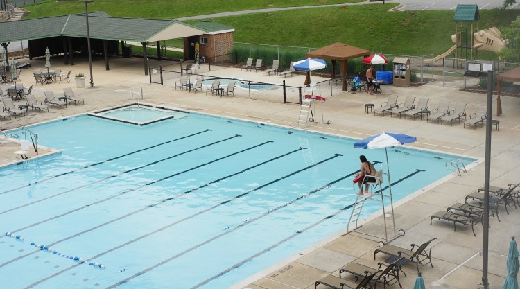 At Turf Valley Resort's outdoor pool, you can order food and enjoy the day relaxing by the water.