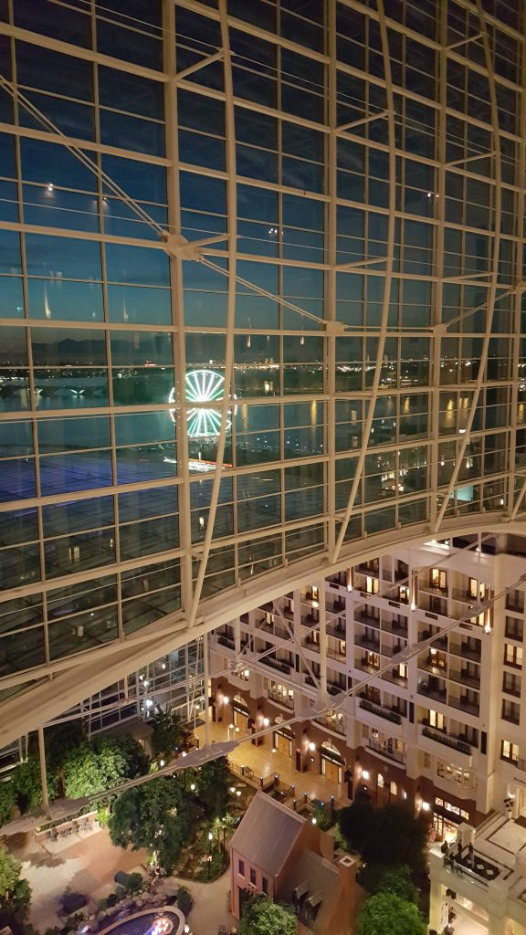 From your balcony at the Gaylord National Resort, you can see the Capital Wheel light up in different colors and patterns.