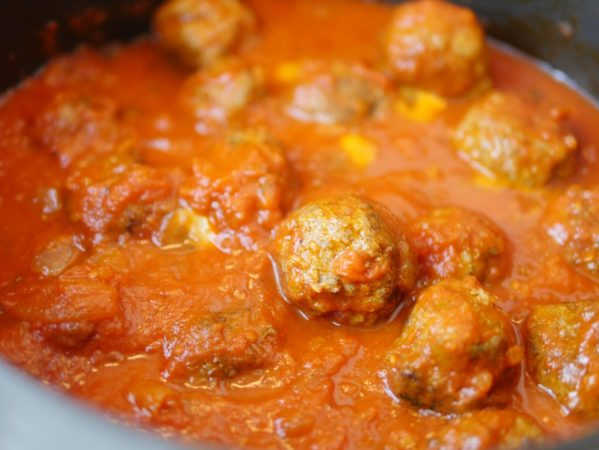 Theresa's Reviews Our Family's Traditional Sunday Meatball Recipe - The longer you can slow cook the meatballs, the better.