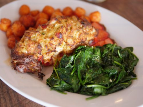 With the Crab Imperial Stuffed Lobster Tail, you get a 5-6 oz. lobster tail stuffed with creamy Chesapeake seasoned, petite lump crab meat. On the side, the dish has sweet potato tater tots and sautéed spinach at Hudson Coastal Raw Bar & Grille - Theresa's Reviews