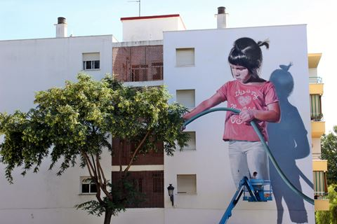 Estepona mural of a girl watering a tree