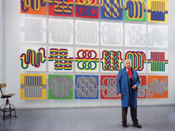The artist Julio Le Parc in his studio in France, in front of 60 one-of-a-kind scarves he designed for Hermès based on his Op Art paintings. The scarves will be shown at the Museum der Kulturen in Basel on June 15, and will be sold exclusively online.Credit Benoît Peverelli