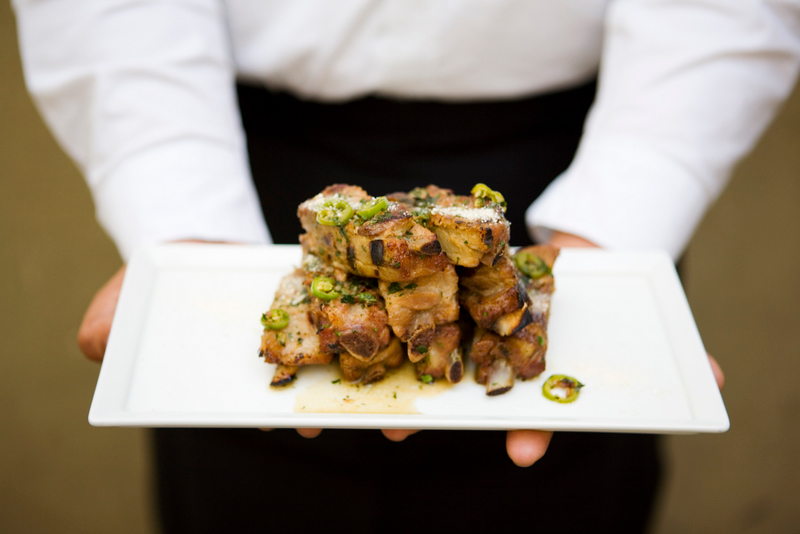 Grilled pork riblets with green onion, serrano chili and lime