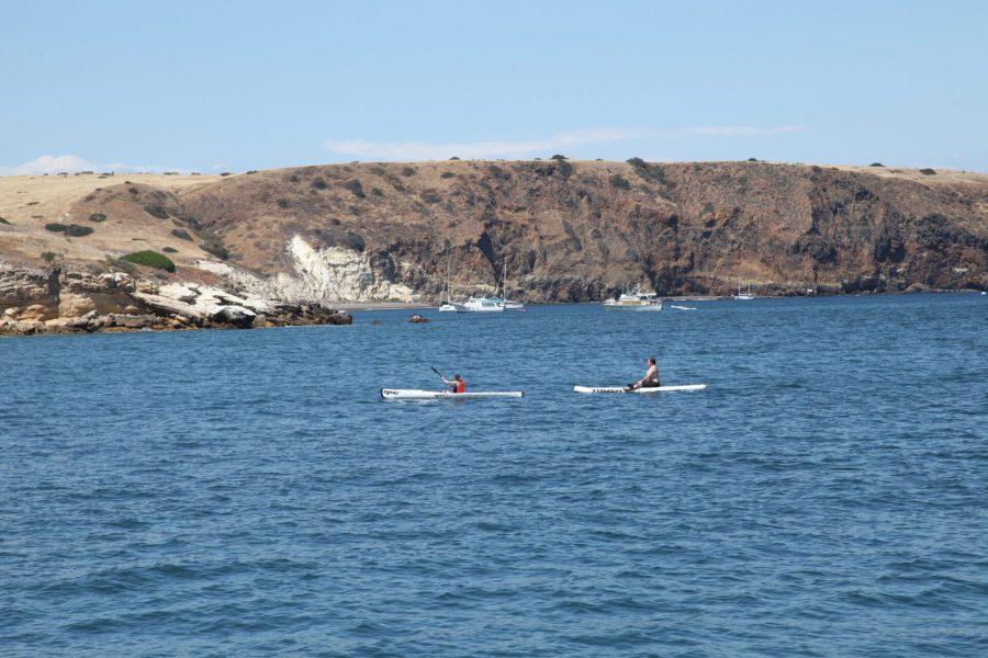 CJ kayaking and Jay paddleboarding