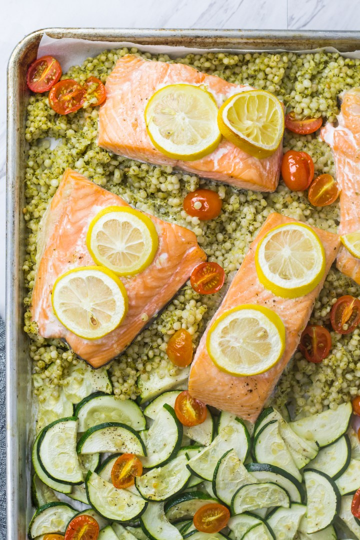 Artichoke, basil, lemon, zucchini and tomatoes baked with Israeli couscous and salmon.