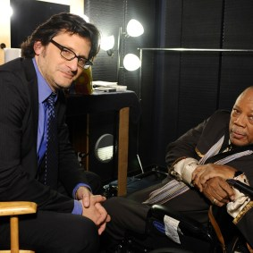 """HOLLYWOOD, CA - APRIL 11: Weekend daytime host of Turner Classic Movies, Ben Mankiewicz and music producer Quincy Jones attend """"The Italian Job"""" Screening during the 2014 TCM Classic Film Festival at The Egyptian Theatre on April 11, 2014 in Los Angeles, California. (Photo by Stefanie Keenan/WireImage) *** Local Caption *** Quincy Jones; Ben Mankiewicz"""