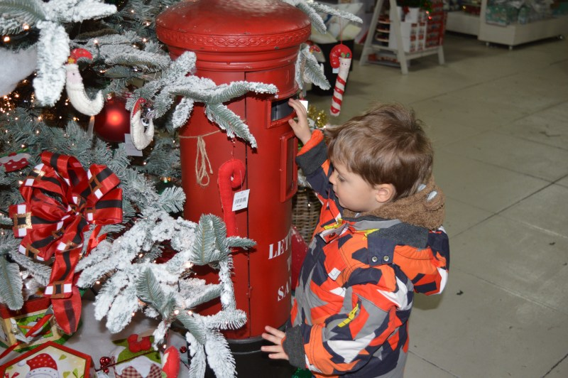 Posting a letter to Father Christmas at Frosts