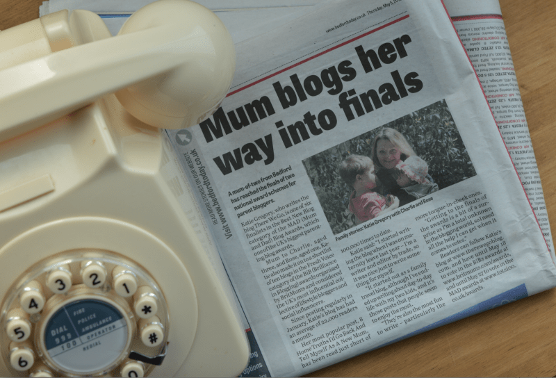 Telephone and newspaper article