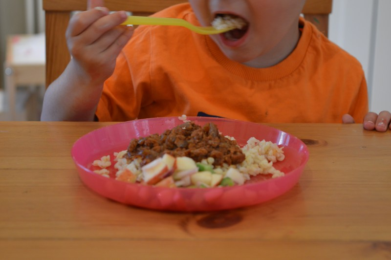 Little boy eating chilli con carne