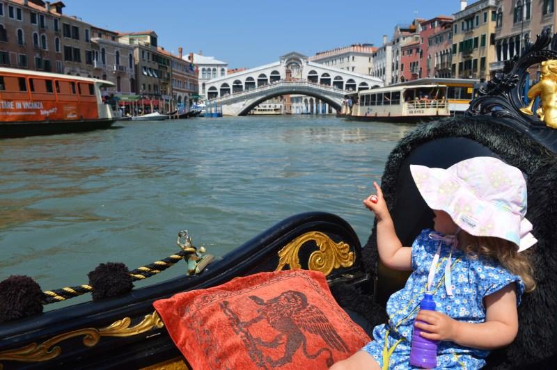Toddler riding a gondola in Venice