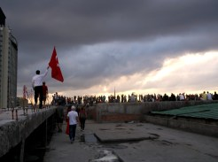 People gather on top of a building at Taksim square, Istanbul
