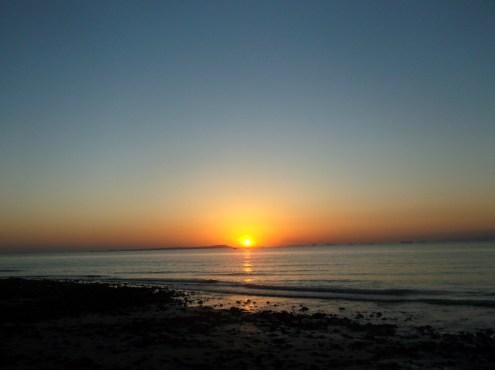 Sun sets over Qeshm in the distance, Hormuz island