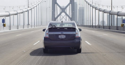 Prius driving on The Golden Gate Bridge With No Traffic