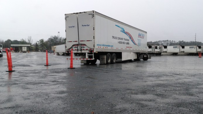 image of backing up a long haul truck