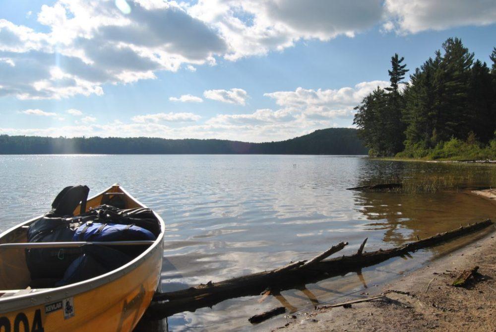 Canoe on a beach on a 5 day canoe trip loop in Algonquin Park