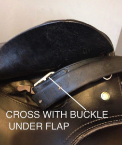 Crossing the stirrup leathers with the buckle up